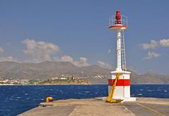 Lighthouse (jack cousin) Tags: sea summer sky lighthouse seascape clouds buildings landscape pier hills greece crete anchor agiosnikolaos