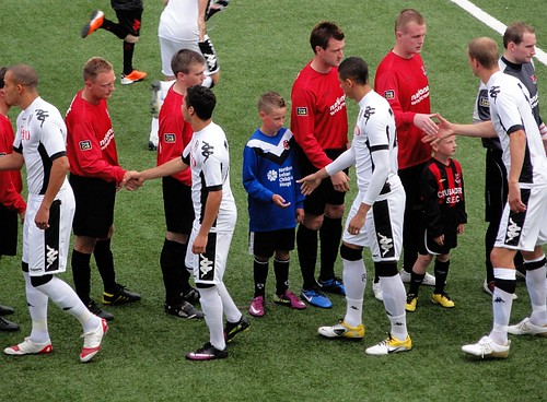 Players and Mascots shake hands