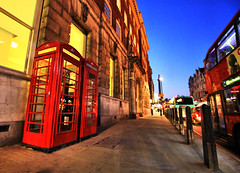London Phone Booths (` Toshio ') Tags: street greatbritain england building bus london car statue architecture booth europe cityscape shadows phone traffic unitedkingdom phonebooth perspective royal trafalgarsquare sidewalk busy bluehour royalty europeanunion nelsonscolumn doubledeckerbus doubledecker cityscene toshio