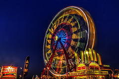 Big Wheel (Uncle Phooey) Tags: blue sunset red orange motion green colors wheel night lights colorful statefair fair ferris missouri spinning ferriswheel bluehour corndogs sedalia