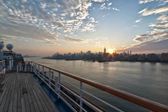 Sunrise over Midtown Manhattan from Cruise Ship (CrapulePHL) Tags: new york nyc cruise carnival sky building water skyline clouds sunrise canon reflections river ship state manhattan iso midtown deck esb empire sunburst hudson 100 usm f80 railing sunrays efs 1022mm hdr 10mm 1250s f3545 160s 115s
