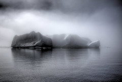 iceberg! iceberg! (mariusz kluzniak) Tags: ocean winter shadow sea white mist snow black cold ice fog america reflections mono bay sony north east arctic greenland iceberg polar alpha 580 kulusuk angmassalik tasiilaq the4elements a580