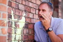 Allergy Season (Rudy Malmquist) Tags: portrait man david male brick wall dave nose kleenex paint michigan blowing grand blow rapids immature hillbilly karel