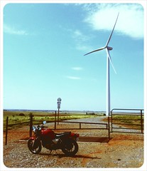 Red Dragon (Ryan Fogle) Tags: street travel blue summer sky green oklahoma windmill bike architecture modern vintage cafe energy wind farm country alien motorcycles roadtrip clean clear dirt heartland future yamaha caferacer gravel racer iphone srx