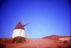 [unwind] ([noone]) Tags: españa windmill 35mm lomo lca xpro crossprocessed procesocruzado spain andalucia cabodegata 2010 molinodeviento mulinoavento processoinverso