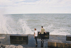 James & Colin (Heidi Uhlman) Tags: park lake chicago film beach wet water colin 35mm james illinois friend waves wind august lakemichigan hyde hydepark splash chicagoillinois sexualinnuendo hydeparkbeach