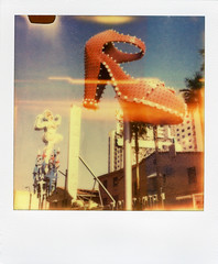 Red Slipper (Nick Leonard) Tags: city morning vegas blue red summer sky signs classic film girl analog vintage polaroid sx70 outdoors downtown neon lasvegas nevada nick lightbulbs scan retro lightleaks signage bulbs fremontstreet landcamera polaroidsx70 polaroidlandcamera instantfilm neonsignage epson4490 colorshade nickleonard redslipper polaroidsx70model2 theimpossibleproject ndpackfilter px60 px680ff fremontsteeteast badshielding