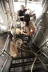 On the Catwalk (jkoshi) Tags: beer brewing colorado longmont brewery brewer tanks brewmaster koshi jkoshi fermenter oskarblues