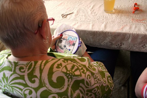 Granny embroidering twiggy look-a-like with a camera <3