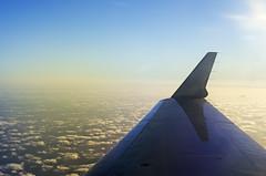 Coming Home (HikerDude24) Tags: ocean sunset sea sky sun water clouds plane airplane nikon wing d5100