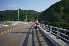 Cycling on the coast of Shakotan Peninsula near Tomari, Hokkaido, Japan