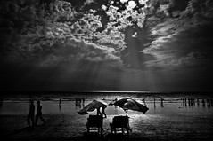 Untitled (Shutterfreak ☮) Tags: people beach monochrome silhouette chairs rays umbrellas bangladesh coxsbazaar inkiad
