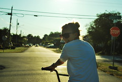 16.52 She's That Summer Glow. (LazyThumbs) Tags: street sun girl smile bike glasses bmx girlfriend pretty glow stopsign flare bikeride sunflare week16 52weeks mybeautifulgirlfriend 52weekproject
