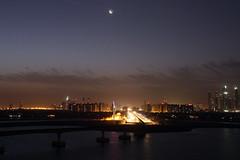 Moon over The Palm (grey0beard) Tags: light sky cloud tower night dark dubai purple bright crane crescent atlantis monorail palmmoon