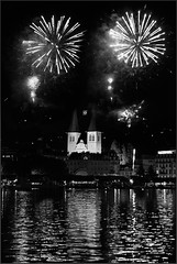 Swiss National Day (Dichtung & Wahrheit (Poetry and Truth)) Tags: blackandwhite reflection water switzerland nightshot fireworks lucerne lakelucerne swissnationalday   stleodegarimhof