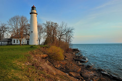 """Sunrise Side""  Point Aux Barques Lighthouse - Port Hope, Michigan (Michigan Nut) Tags: usa lighthouse horizontal america sunrise season outdoors spring midwest rocks waves michigan shoreline landmark nautical lakehuron pointauxbarqueslighthouse nikon1635mmf4gedafsvrwideanglezoomlens"