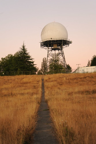 Radar tower in the form of Supermans snowball, path through the golden grass of August, Discovery Park, Seattle, Washington, USA by Wonderlane