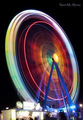 Gira Gira Rueda Rueda... (Nuria M. Alonso) Tags: luces nikon feria movimiento nocturna larga noria alcala atracciones exposicin alcaldehenares largaexposicin lucesdecolores nikonista d3000 nikond3000 atraccionesferia 2mil11 nuriamalonso feria2mil11 feriaalcal photonury nuriamalonsofotografa