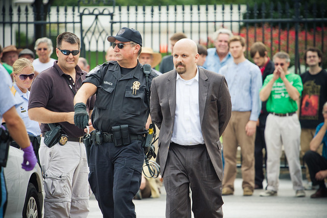 Greenpeace USA executive director being arrested in front of the White House.