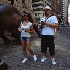 engrossed in man with snake (Mightyhorse) Tags: street new york city wall district bull financial kiev60 fujiprovia100rdp flektogon50mmf4