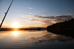 Fishing (rasenkantenstein) Tags: sunset sky cloud lake fish water forest fishing finnland outdoor ripple sommer rod splash kajaani 2011 acitivity