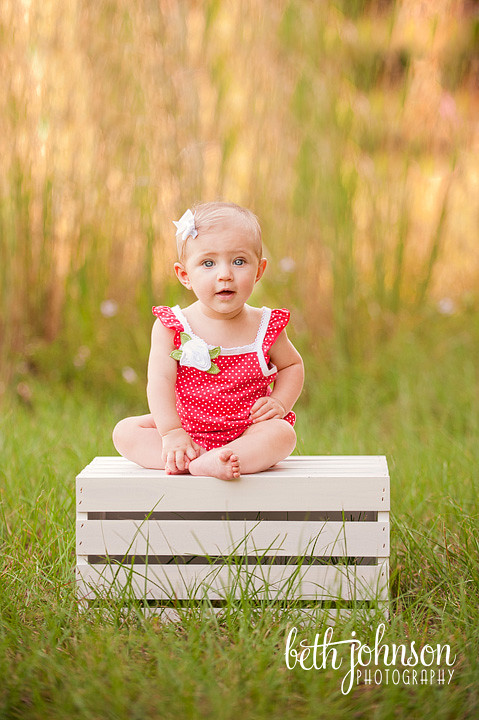 six month old baby girl in red romper white crate tallahassee
