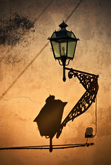 The Lantern and her Shadow (Yuliya Bahr) Tags: light shadow italy yellow wall architecture florence details lantern