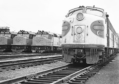 Southern Railway EMD E8A unit # 6911, plus three more units assigned to the Southern Crescent along with Amtrak EMD SDP40F locomotives are seen in the Ivey City Railroad Yard at Washington, D.C., June 1976 (alcomike43) Tags: old railroad blackandwhite bw classic yard train vintage ties washingtondc photo track diesel engine historic crescent negative amtrak photograph rails locomotive ballast rightofway dieselengine southernrailway railroadyard emd roadbed diesellocomotive dieselelectriclocomotive e8a sdp40f iveycity iveycityrailroadyard conventionaljointedsectionrail conventionalpassengerequipment