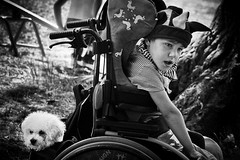 A little jester 2 (Boy With The Coin) Tags: boy portrait blackandwhite bw dog monochrome face canon eos eyes sad jester wheelchair structure toned lowkey jingles handicapped 400d silverefexpro