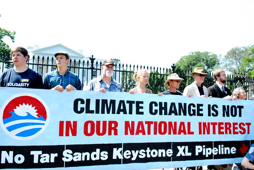 """Tar Sands protestors stand up against the Keystone pipeline"" by Tarsandsaction on flickr - photo credit Amy Dewan"