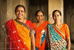 Posing in Orange (viwehei) Tags: ladies madame orange woman india beautiful stone lady female wonderful mujer ancient women asia power gorgeous indian traditional caves frau mujeres sari frauen ellora unsecoworldheritage