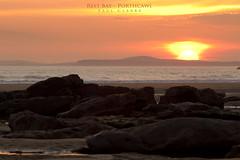Rest Bay (Axleuk) Tags: sunset sea sky people sun seascape reflection tourism beach water southwales wales landscape sand rocks vista pinksky bridgend bristolchannel greenseaweed restbayporthcawl