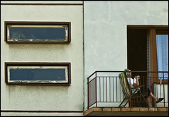 Reading (jotemel) Tags: old windows woman chair geometry candid balcony polska seating lublin lbn jotemel