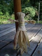 Corn husk doll with braided arms