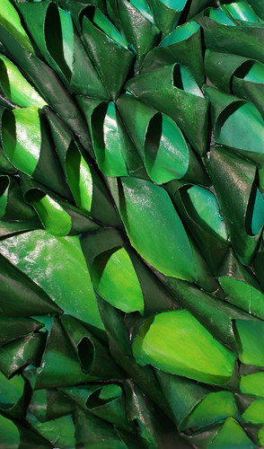 detail of sculptural bas relief  pod painting in various shades of green. Made of recycled cardboard tubes and acrylic paint.
