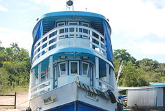 FERRY BOAT CARRING FREIGHT TO THE SMALL VILLAGES ON THE RIO NEGRO RIVER. (vermillion$baby) Tags: amazon brazil international rionegro boat river ferry freight blue door window workboats work freshwater boats ferryferryboat bow water travel world amazone
