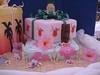 Luau gifts tiki closeup (Cake Diane Custom Cake Studio (eyedewcakes)) Tags: birthday beach cake island hawaii sand plumeria shell hibiscus luau pineapple bow tropical frangipani loopy tiki fondant loopybow