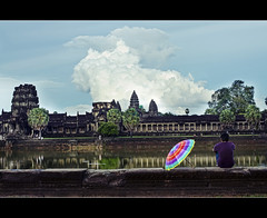 nostalgia is a bittersweet feeling... (PNike (Prashanth Naik)) Tags: sky man reflection water architecture umbrella temple nikon colorful asia cambodia sitting view angkorwat nostalgia feeling siemreap angkor wat d7000 pnike