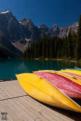 Canoes for Hire (Mick Clarke Photography) Tags: blue trees wild mountain lake canada green water clouds canon landscape rockies eos countryside boat day native canadian canoe glacier alberta rockymountains emerald moraine icefieldsparkway 50d snakeoilimages