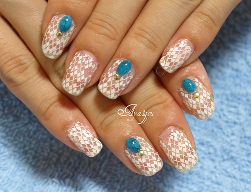 Konad manicure with faux turquoise