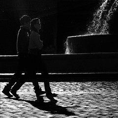 Pas de Deux (fifich@t / Franoise) Tags: street shadow blackandwhite bw paris france silhouette backlight pavement streetphotography nb grayscale cobbles contrejour controluce greyscale ombres pavs copyright streetpicture squarepicture allrightsreserved classicbw parisinblackandwhite formatcarr squarephotography copyrightallrightsreserved tousdroitsrservs nikond300 blackisthecolour featuredfrontpagewinners digimarc2011 asquaresuperstarstemple lightroomps fifichat1 frs frs
