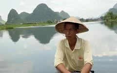 Guilin Raft Captain (cowyeow) Tags: china travel man reflection nature water hat rural river asian boat asia guilin chinese dude captain serene guangxi