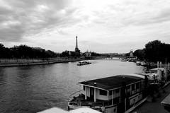 (Riccardo Villani) Tags: old light summer cloud white black paris seine canon vintage river eos boat grain eiffel toureiffel senna bateaumouche 550d