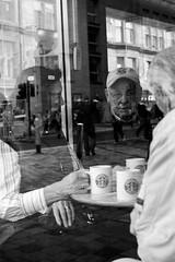coffee break (Magne M) Tags: old uk people woman man reflection cup window coffee café monochrome glasses scotland blackwhite britain glasgow tourist cap starbucks elderly discussion chatting sauchiehallstreet lifethroughawindow