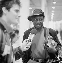 Mat Marrash Interviewing Louis Mendez at Photo Plus (MyNameIsHunter) Tags: white  120film hunter ilfordhp5plus400 2012 hasselblad500cm nikoncoolscan9000 sprintdeveloper louismendez matmarrash