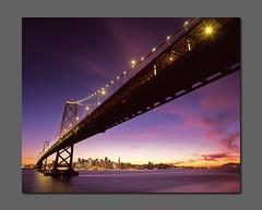Color Under the Bridge (RZ68) Tags: city bridge pink sunset red west color 120 film skyline clouds buildings reflections island bay san francisco long exposure cityscape treasure side under velvia western 6x7 yerba provia span afterglow buena rz67 sanfranciscobaybridge e100 rz68