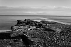 Sebastion Beach (tylermielnichuk) Tags: longexposure winter bw canada motion water canon prime bc smooth pacificocean 7d nd silky lantzville weldingglass sigma30mmf14exdchsm fixedfocallength sebastionbeach sigmalensesgroup