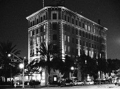 The Culver Hotel - Nikon FE - Nikkor-SC 55mm F/1.2 - TMAX 3200 (divewizard) Tags: california blackandwhite bw white black brick blancoynegro film blanco branco architecture analog 35mm hotel blackwhite analgica nikon tmax3200 downtown noir y noiretblanc kodak tmax negro rangefinder preto historic 55mm e fe