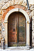 Old Wooden Door with Letter Slot in Italy (Dasha Rosato Photography) Tags: door travel red italy brown building brick beige europe doors arch architecturaldetail entrance arches doorway portal exit traveling bergamo lombardia portals doorknocker travelled traveled lombardy buildingmaterials brickred arched clayproducts buildingmaterial constructionmaterial marblestone woodproducts