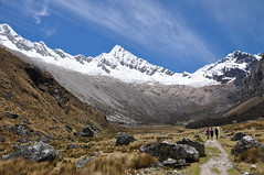 Surrounded by jagged snowy peaks (nic0704) Tags: camping sun mountains peru set america trekking trek walking south tent andes peaks valleys huaraz cashapampa